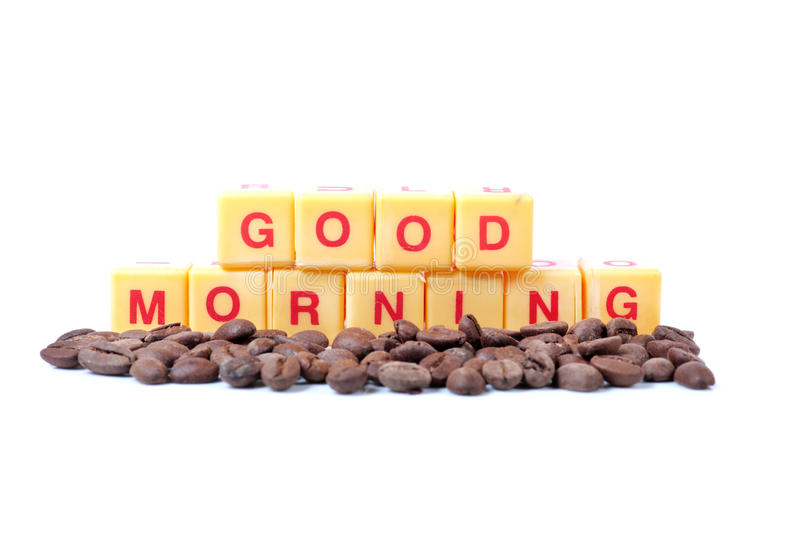 Good morning. Beautiful shot showing coffee beans with good morning written on yellow coloured blocks stock image