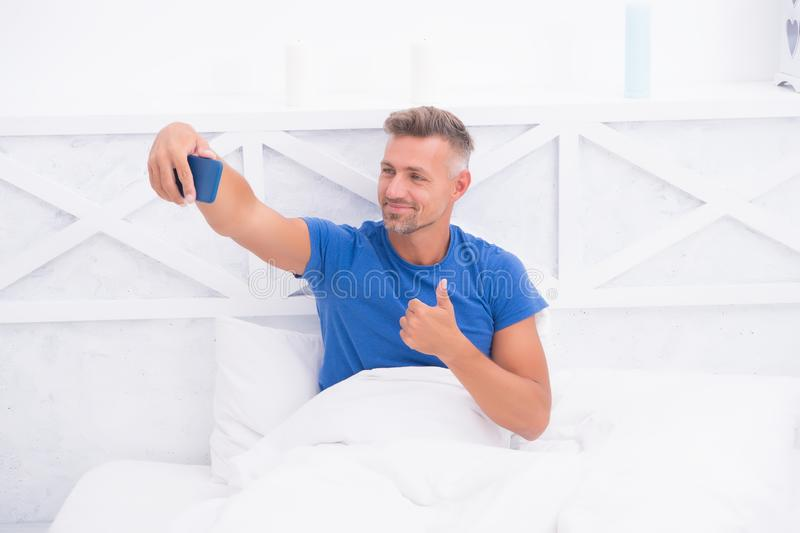 Good morning. Blog online content. Personal blog concept. Good morning. Man taking selfie photo smartphone. Streaming royalty free stock images