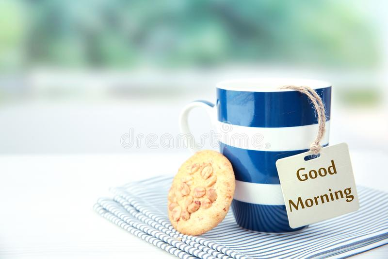 Good morning breakfast concept.Mug with cookie. Good morning concept.Coffee tea mug with cookie and tag with words.Morning breackfast stock images