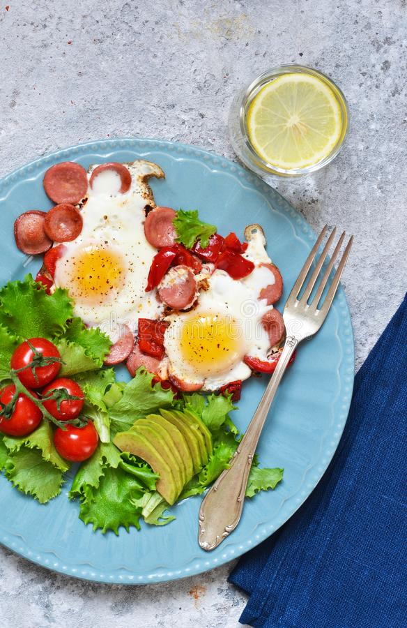 Good morning! Breakfast fried eggs with sausage and pepper. View from above. Good morning! Breakfast fried eggs with sausage and pepper stock images