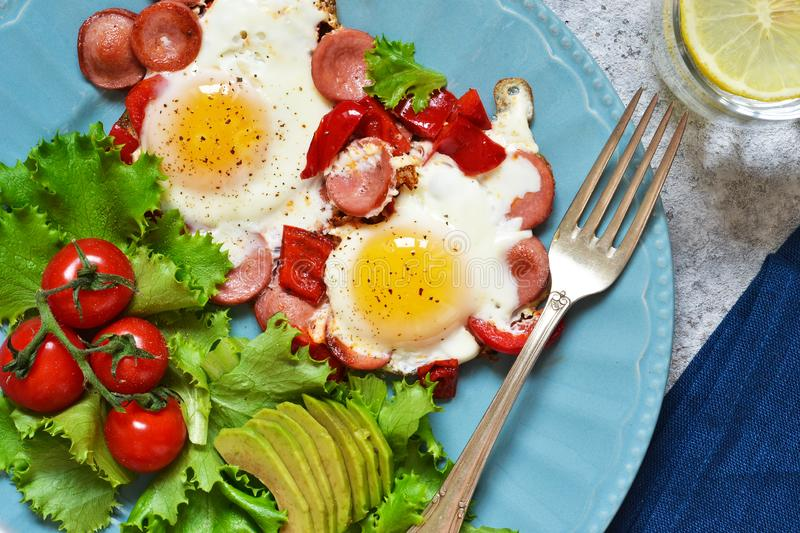 Good morning! Breakfast fried eggs with sausage and pepper. View from above. Good morning! Breakfast fried eggs with sausage and pepper stock photography