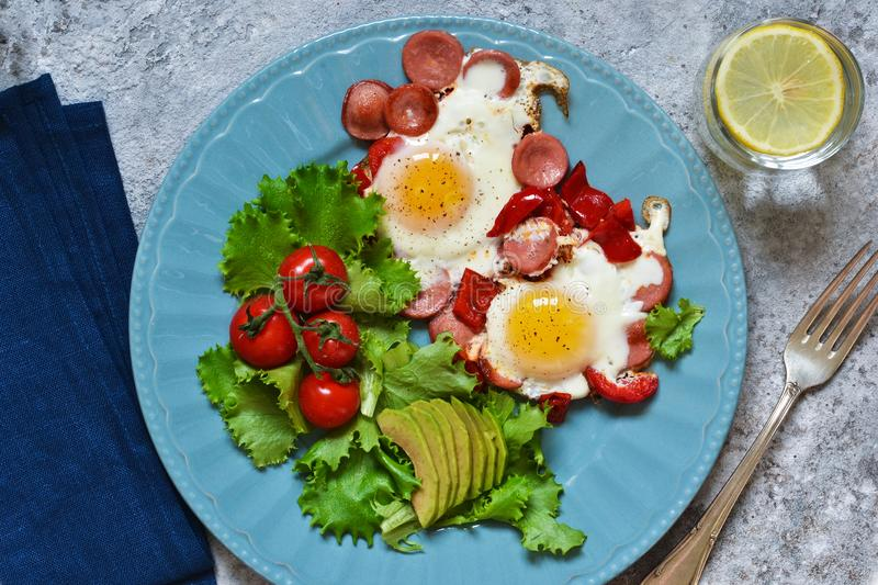 Good morning! Breakfast fried eggs with sausage and pepper. View from above royalty free stock image