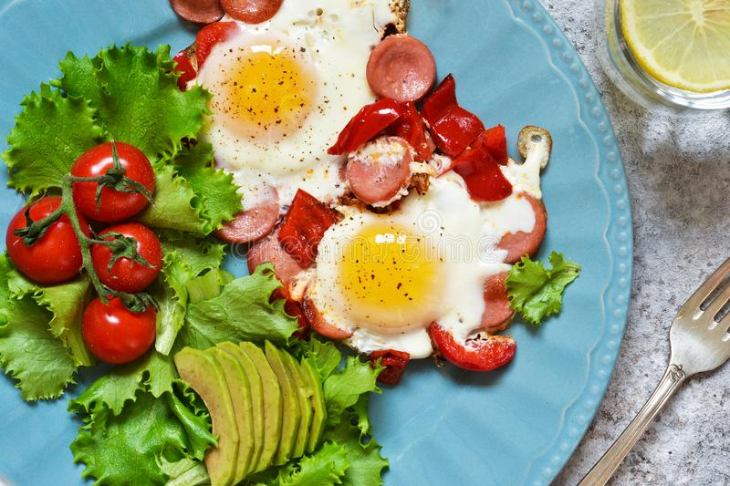 Good morning! Breakfast fried eggs with sausage and pepper. View from above. Good morning! Breakfast fried eggs with sausage and pepper royalty free stock photography