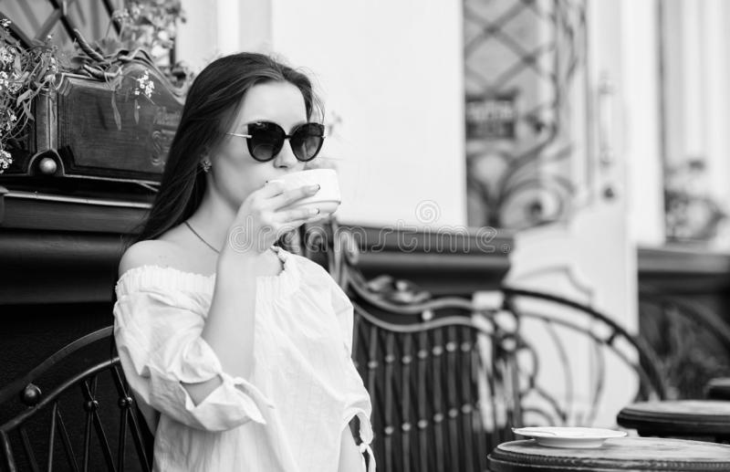 Good morning. Breakfast. girl relax in cafe. Business lunch. stylish woman in glasses drink coffee. summer fashion. Fresh coffee tastes delicious. Meeting in royalty free stock images