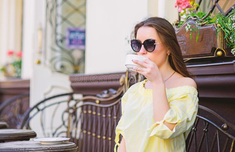 Good morning. Breakfast. girl relax in cafe. Business lunch. stylish woman in glasses drink coffee. summer fashion stock images