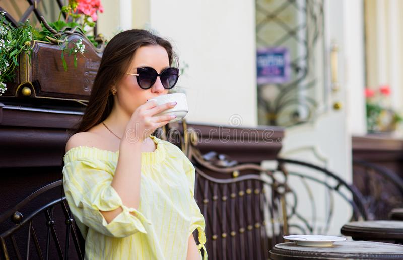 Good morning. Breakfast. girl relax in cafe. Business lunch. stylish woman in glasses drink coffee. summer fashion. Fresh coffee tastes delicious. Meeting in royalty free stock photo