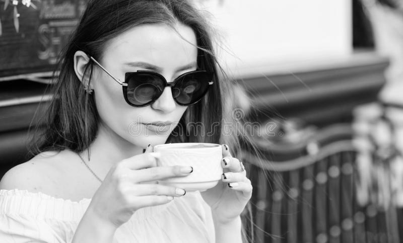 Good morning. Breakfast time. stylish woman in glasses drink coffee. girl relax in cafe. Business lunch. morning coffee stock photos