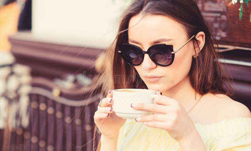 Good morning. Breakfast time. stylish woman in glasses drink coffee. girl relax in cafe. Business lunch. morning coffee. Waiting for date. summer fashion royalty free stock photo