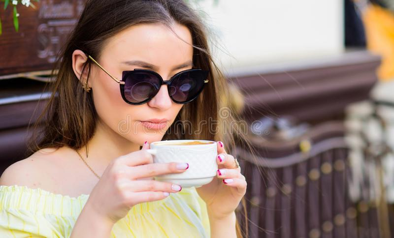 Good morning. Breakfast time. stylish woman in glasses drink coffee. girl relax in cafe. Business lunch. morning coffee. Waiting for date. summer fashion stock images