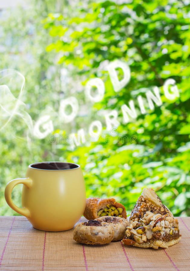 Good morning cloud massage. Ceramic cup with hot drink and east stock photos