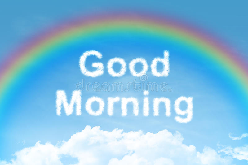 Good morning cloud text with rainbow. On blue sky stock photo