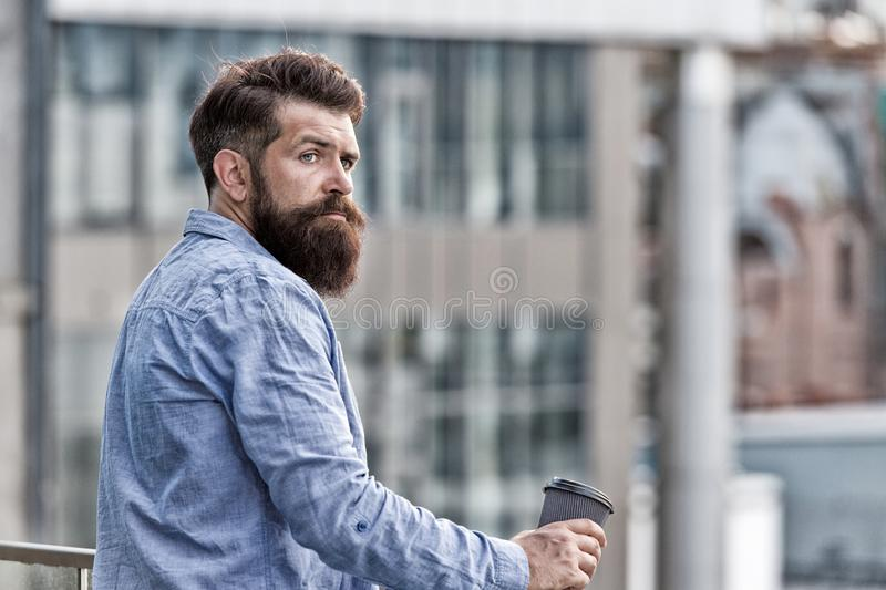 Good morning coffee. brutal hipster with coffee cup. energy charge. Male barber care. copy space. thoughtful man drink. Take away coffee. morning coffee. Mature stock photo