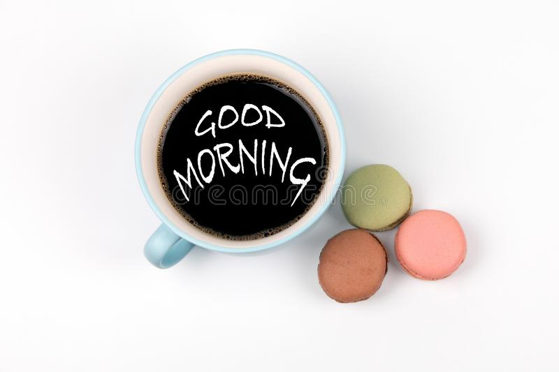 Good Morning. coffee mug and macarons biscuits. On a white table stock images