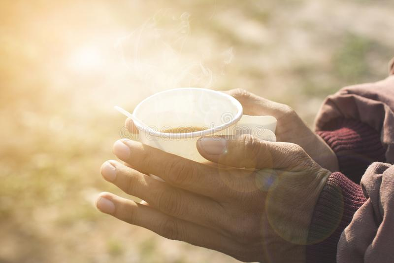 Good morning coffee in a paper cup. Good morning coffee in a paper cup in the hands of men in winter royalty free stock photos