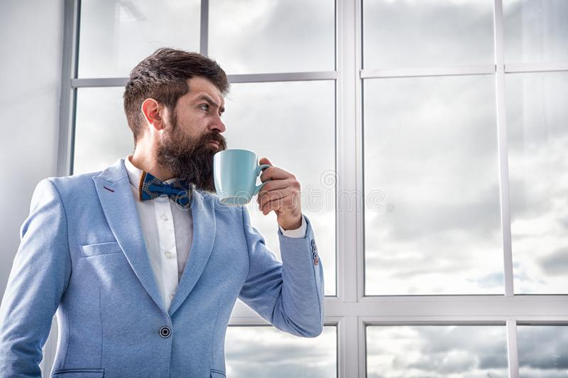 Good morning coffee. serious bearded man drink coffee. businessman in formal outfit. modern life. business man at window. Future success. morning inspiration stock photography