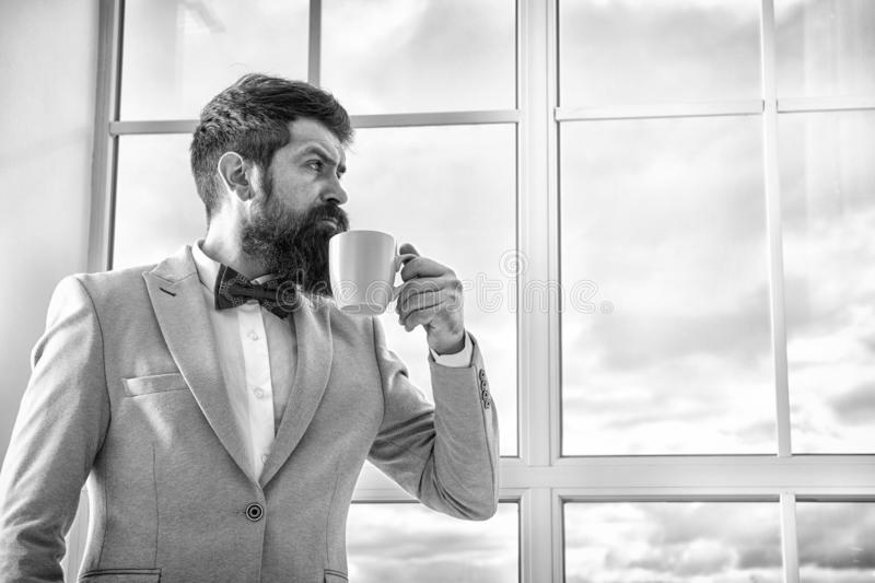 Good morning coffee. serious bearded man drink coffee. businessman in formal outfit. modern life. business man at window royalty free stock photos