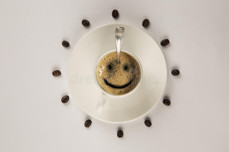 Good morning coffee smile cup on wooden background stock photography