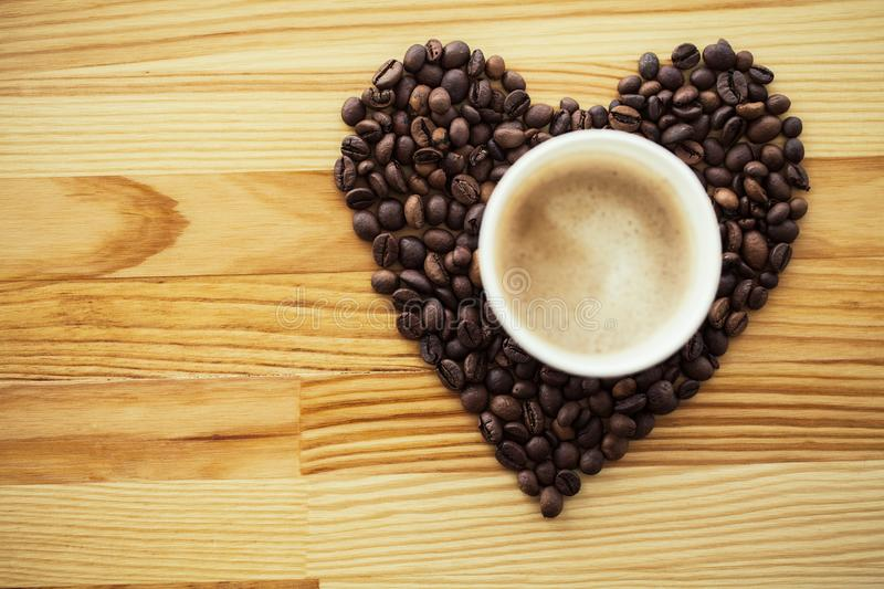 Good Morning. Coffee Time. Coffee to go and beans on a wooden ba. Ckground royalty free stock photo