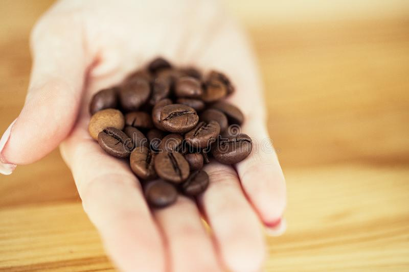 Good Morning. Coffee Time. Coffee to go and beans on a wooden background.  stock image