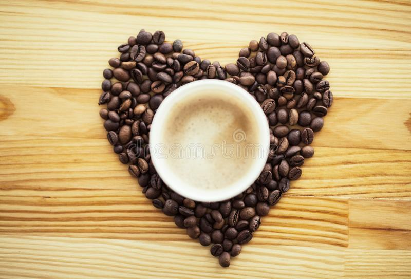Good Morning. Coffee Time. Coffee to go and beans on a wooden background.  stock photos