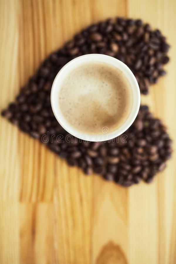 Good Morning. Coffee Time. Coffee to go and beans on a wooden background.  royalty free stock photos