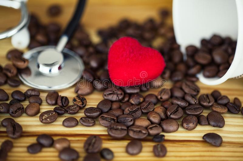 Good Morning. Coffee Time. Coffee to go and beans on a wooden background.  royalty free stock image