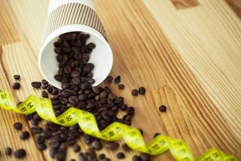 Good Morning. Coffee Time. Coffee to go and beans on a wooden ba. Ckground royalty free stock photos