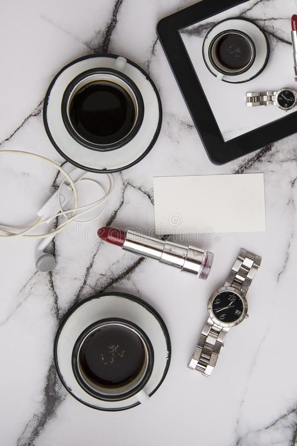 Good morning coffee with woman accessories with marble table top on a lazy sunday. Lifestyle conception stock photo