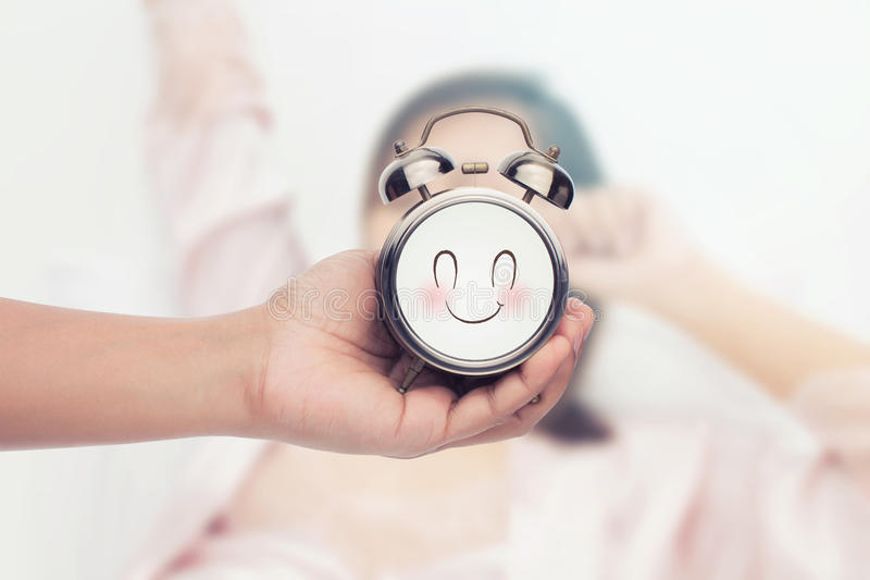 Good Morning concept,The alarm clock. On yawn woman background stock photos
