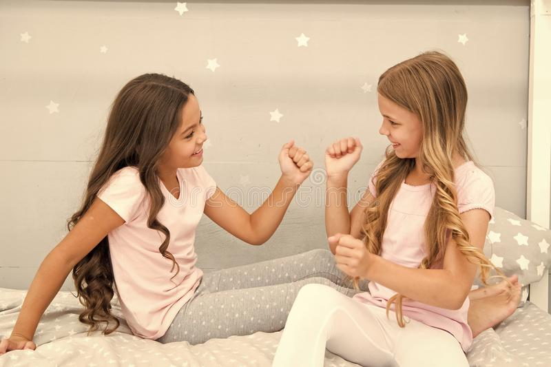 Good morning concept. Children cheerful play bedroom. Great start of day. Happy childhood moments. Joy and happiness. Happy together. Kids girls sisters best royalty free stock photos