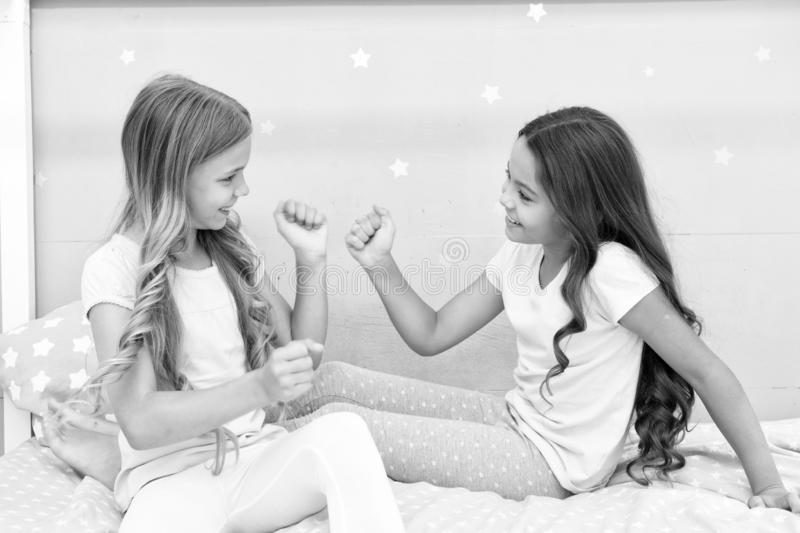 Good morning concept. Children cheerful play bedroom. Great start of day. Happy childhood moments. Joy and happiness. Happy together. Kids girls sisters best stock image