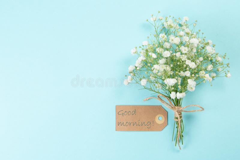 Good morning concept - coffee, flowers, notebook. Blue background top view stock images