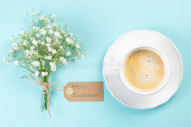 Good morning concept - coffee, flowers, notebook. Blue background top view royalty free stock images