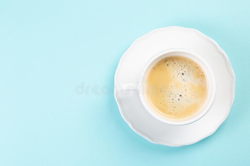 Good morning concept - coffee, flowers, notebook. Blue background top view royalty free stock image