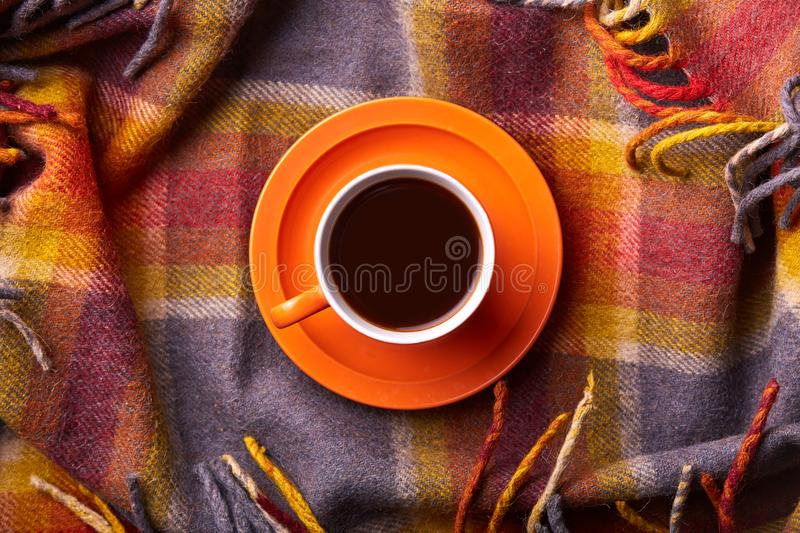 Good morning concept. Domestic and home atmosphere. Cup of hot tea on coverlet. Cozy composition with mug of coffee. Flat lay, top. View. Having drink in bed royalty free stock photo