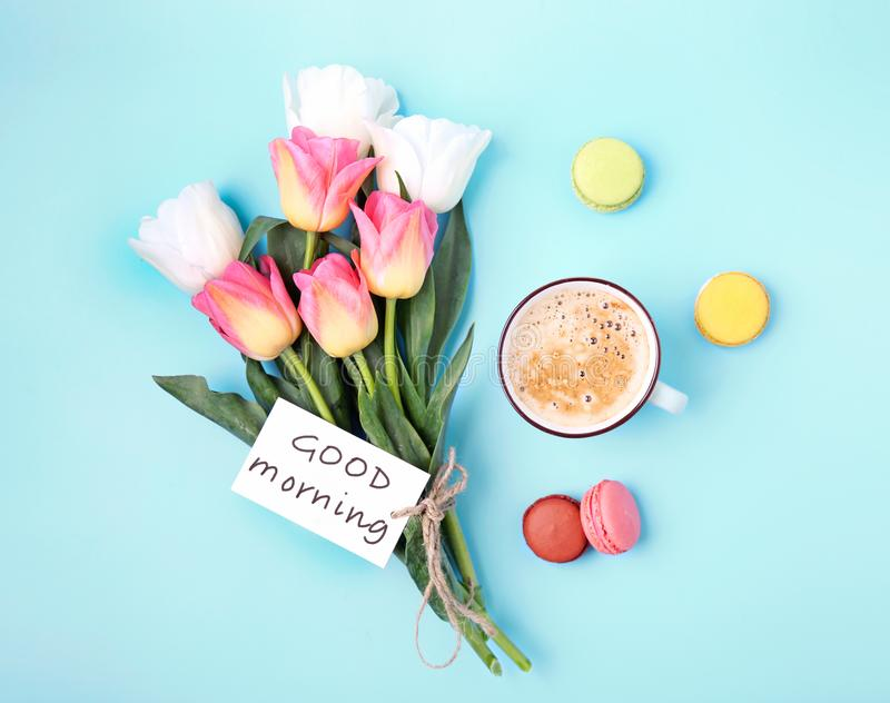 Good morning concept. Flowers and coffee top view. Good morning concept.Flowers,coffee and macaroons top view royalty free stock image