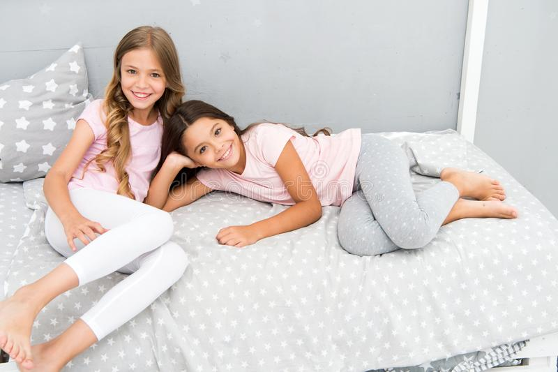 Good morning concept. Great start of day. Children cheerful play bedroom. Happy childhood moments. Joy and happiness. Happy together. Kids girls sisters best stock images