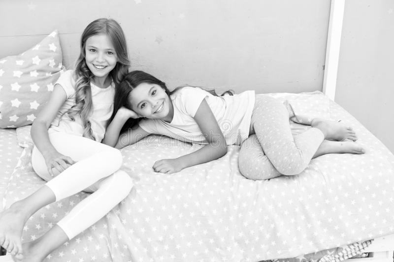 Good morning concept. Great start of day. Children cheerful play bedroom. Happy childhood moments. Joy and happiness. Happy together. Kids girls sisters best royalty free stock images