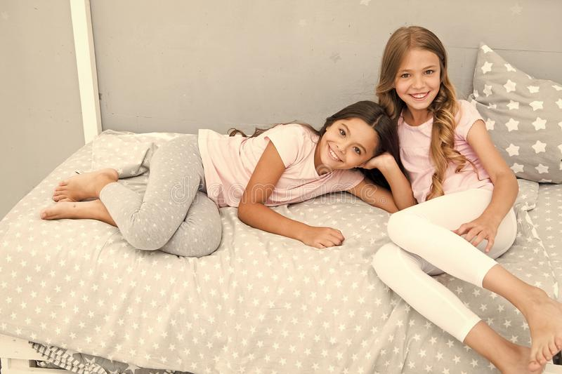 Good morning concept. Great start of day. Children cheerful play bedroom. Happy childhood moments. Joy and happiness. Happy together. Kids girls sisters best stock image