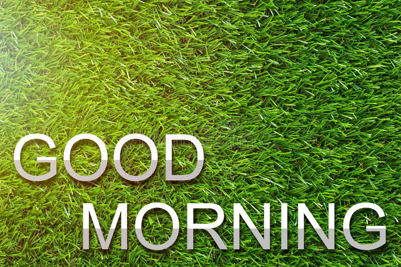 Good Morning Concept. Good morning and wake up concept, greeting paper cut text on green grass background stock photos