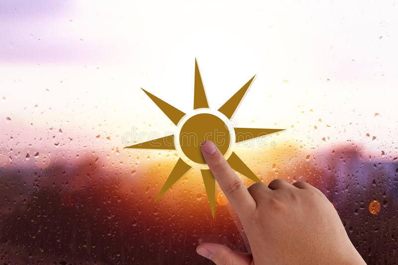 Good Morning Concept. Good morning and wake up concept, hand holding sun paper cut on glass background, rain and water drop stock images