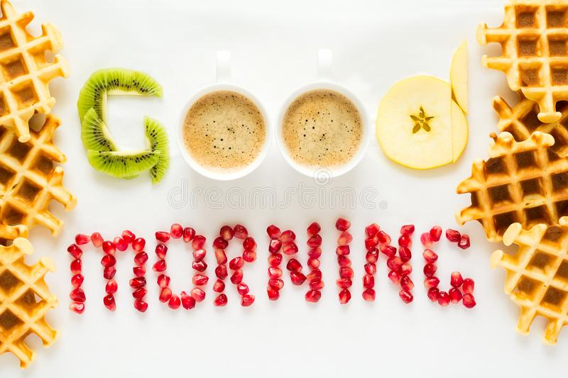 Good morning concept. `Good morning` words laid out with pieces of fruit and pomegranate seeds. stock photos