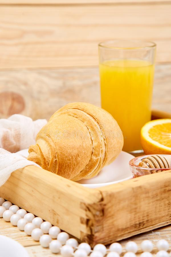Good morning. Continental breakfast on ristic wooden background. Good morning.Continental breakfast on ristic wooden background. Cup of coffee, orange juice royalty free stock photo
