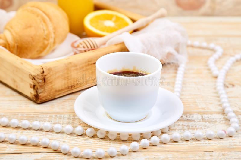 Good morning. Continental breakfast on ristic wooden background. Good morning.Continental breakfast on ristic wooden background. Cup of coffee, orange juice royalty free stock image