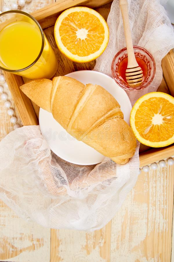 Good morning. Continental breakfast on ristic wooden background. Good morning.Continental breakfast on ristic wooden background. Cup of coffee, orange juice stock photos