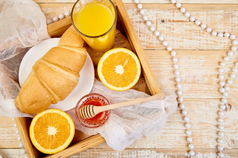 Good morning. Continental breakfast on ristic wooden background. Good morning.Continental breakfast on ristic wooden background. Cup of coffee, orange juice royalty free stock photos