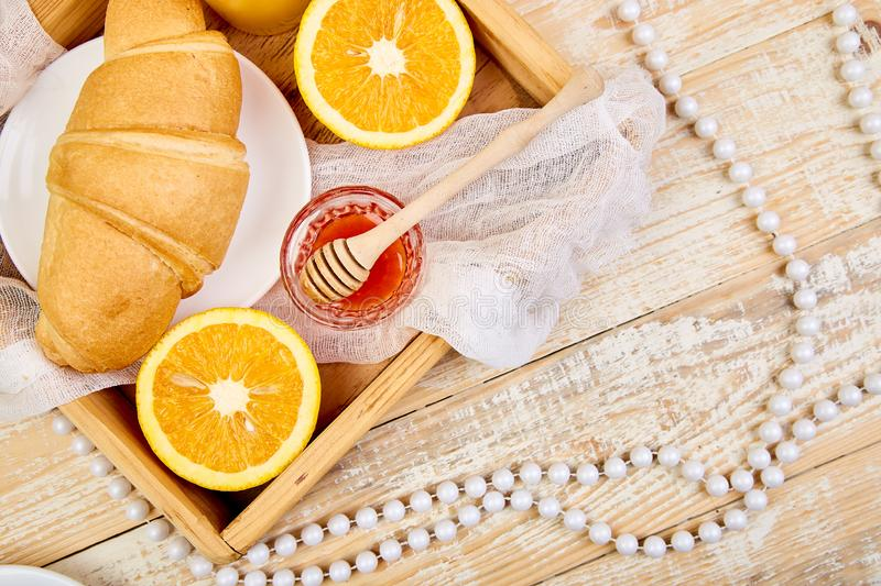 Good morning. Continental breakfast on ristic wooden background. Good morning.Continental breakfast on ristic wooden background. Cup of coffee, orange juice stock photography