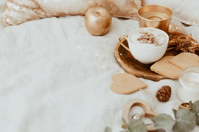 Good Morning. Cozy Still Life background. With coffee cup and cookies on bed royalty free stock photo