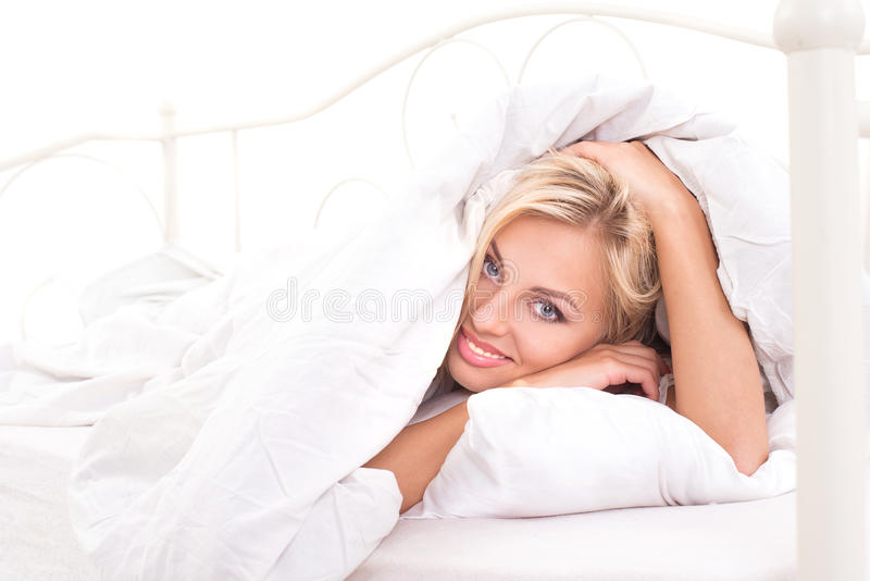 Good morning for cute blonde. Lying in bed royalty free stock image