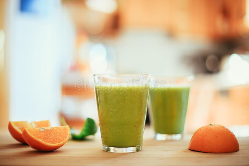 Good morning: Fresh green smoothies and fruits in the kitchen, healthy breakfast. Arrangement of a fresh green healthy smoothies and fruits in the kitchen stock photos